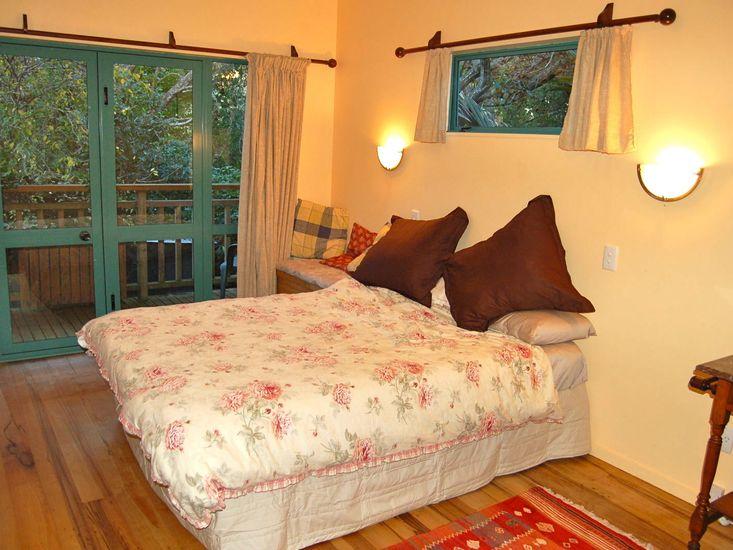 Bedroom with wooden floors