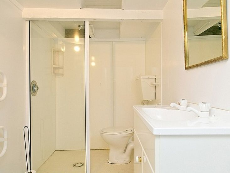 Converted basement/rumpus room bathroom *note this shower is disconnected, toilet/basin only*