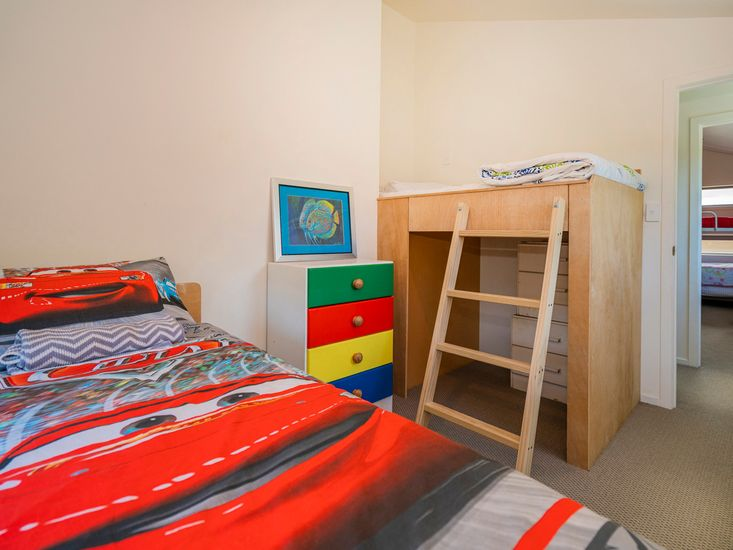 Bedroom 5 with a single bed and a raised bunk bed - Upstairs