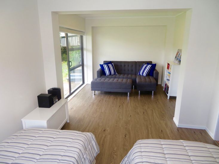 Relax in the downstairs lounge room - No internal access