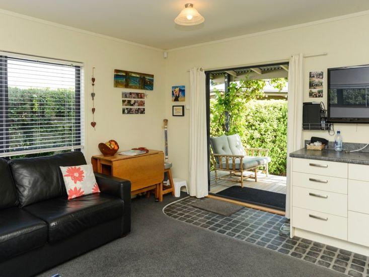 Living room/kitchen/outdoor deck