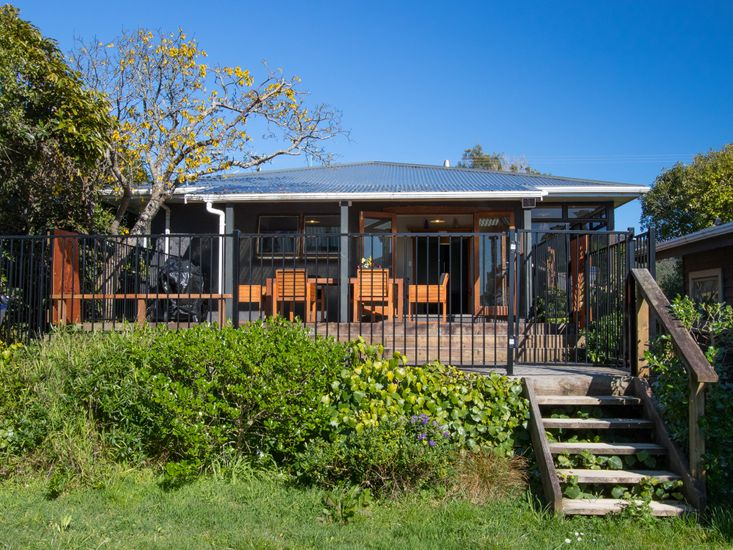 Easy access to the beach and full fenced decking!