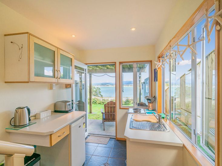 Downstairs Apartment Kitchenette with Ocean Views!