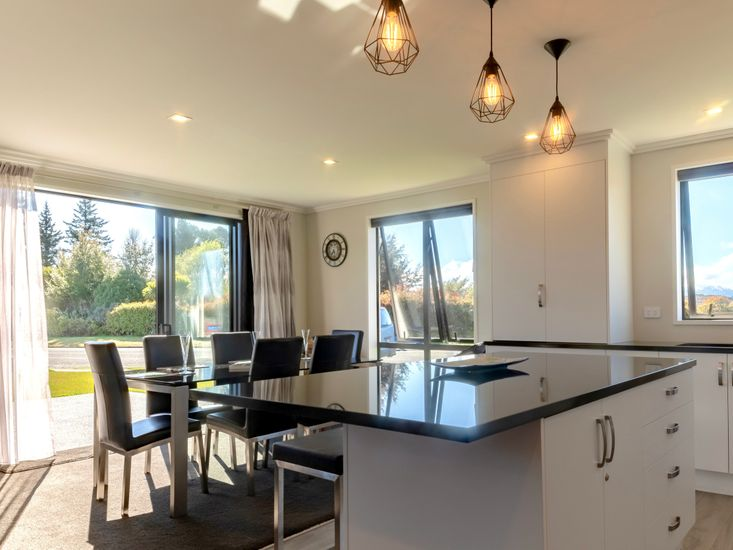 Kitchen onto dining table and access to sunny outdoor patio