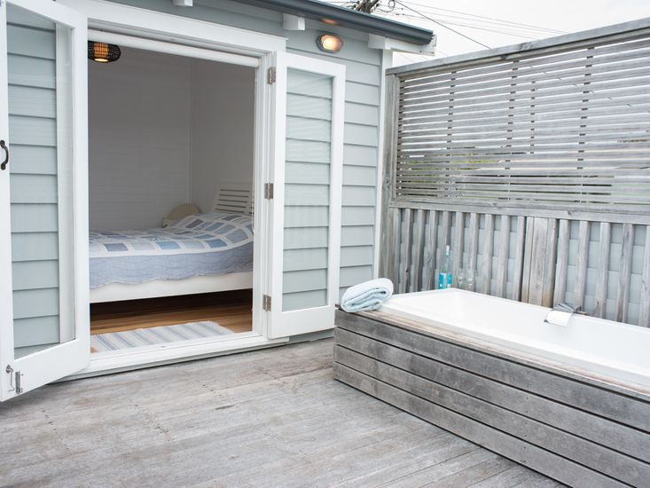 Master bedroom onto decking with outdoor bath