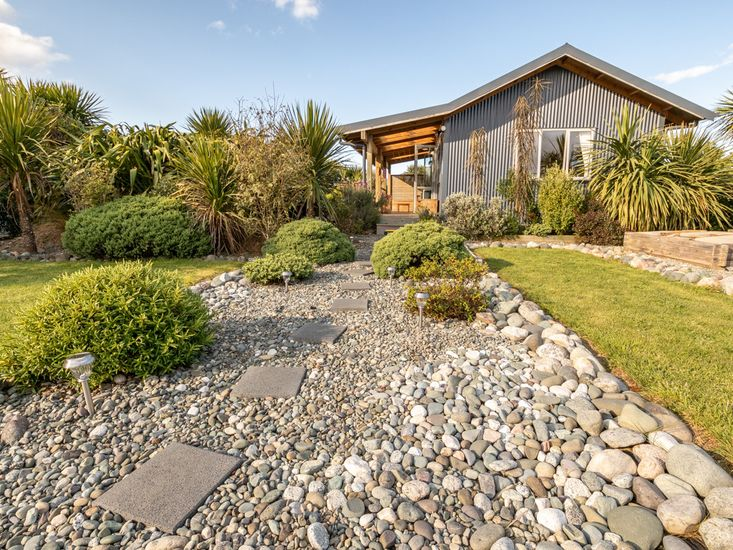 Landscaped front lawn and garden