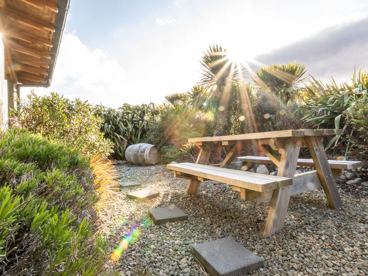 Outdoor living and dining area in the landscaped garden