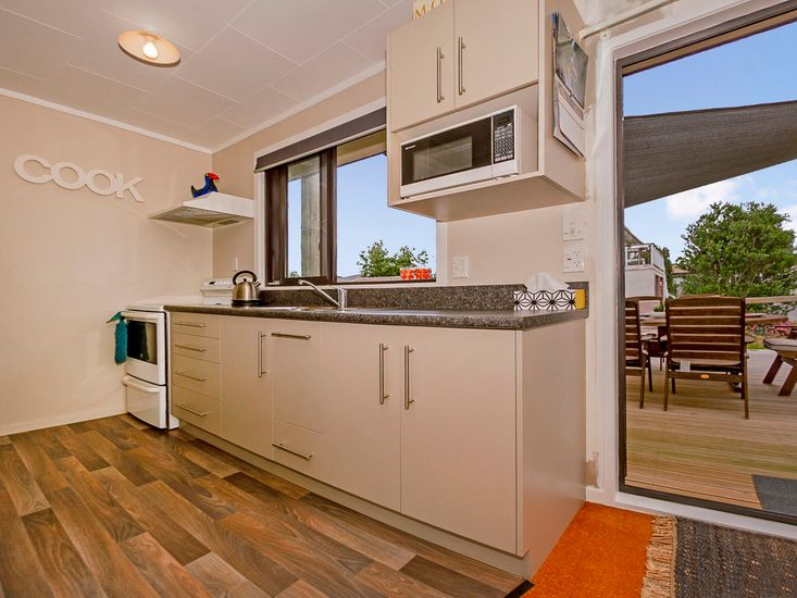 Kitchen and access to outdoor dining and BBQ deck