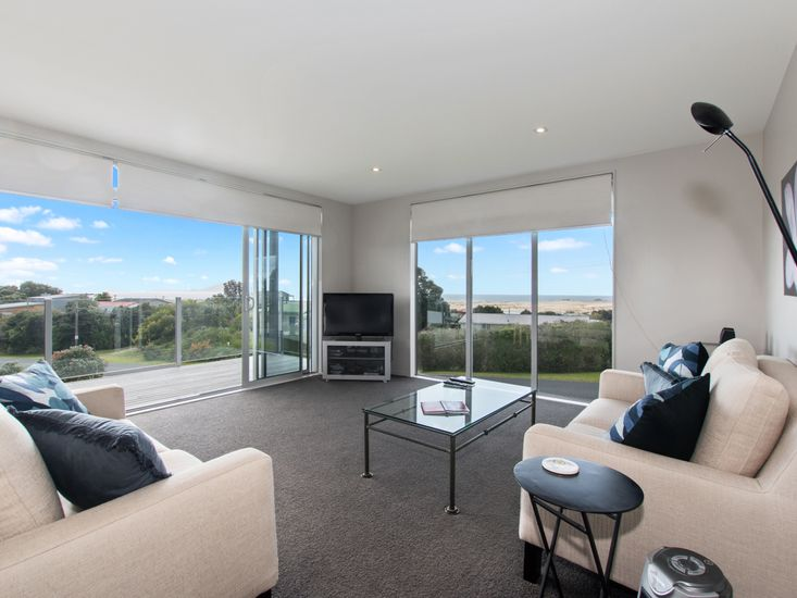 Lounge onto deck and views over the Mangawhai sand dunes