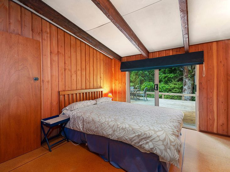 Master bedroom opens out to the deck