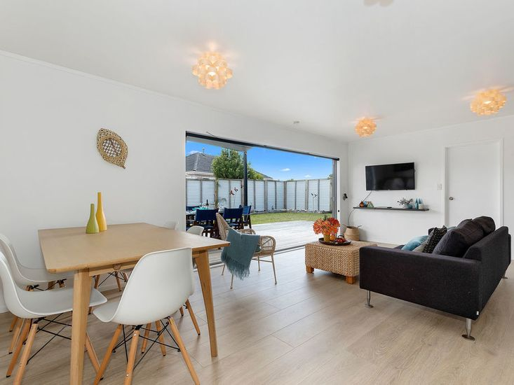 Open living area flowing out onto outdoor decking