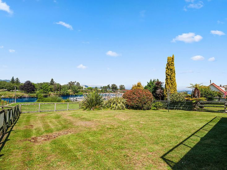 Large flat lawn and garden area