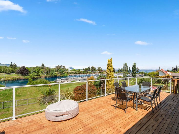 Sun drenched decking looking out over the Waikato and Boat harbour