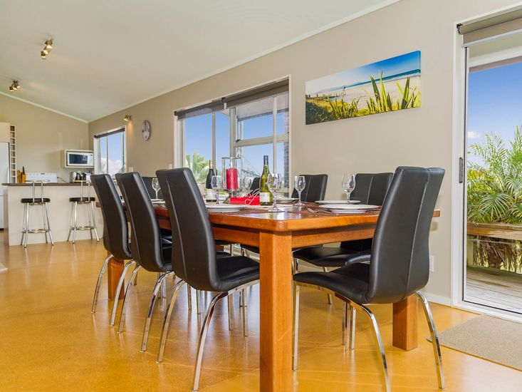 Family size dining table in the open plan living area