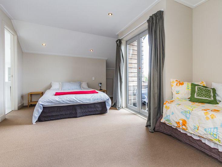 Bedroom Three - Queen and Single Beds