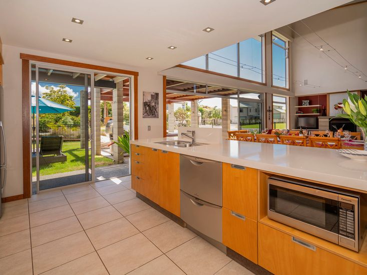 Breakfast bar and kitchen opens out the sheltered patio