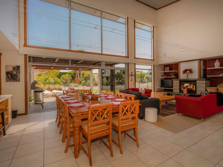 Open plan living area flows out to the patio and BBQ area