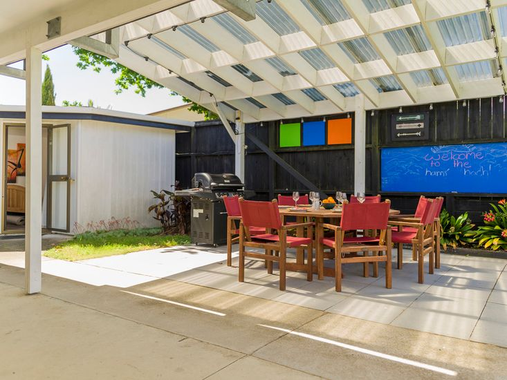 Sheltered dedicated BBQ and outdoor dining space!