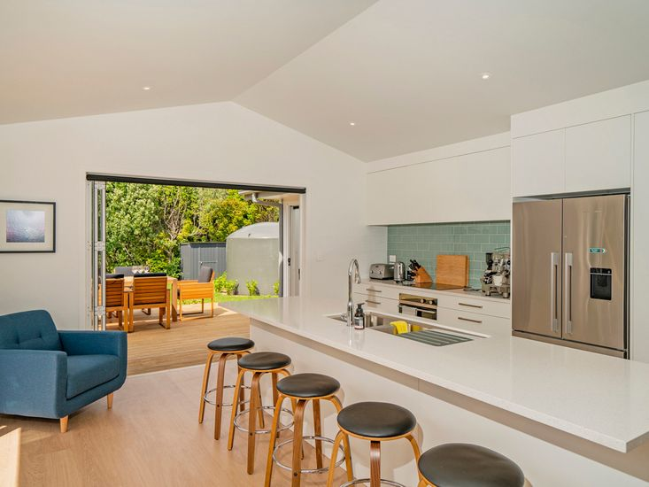 Breakfast bar and kitchen opens out to the sundeck