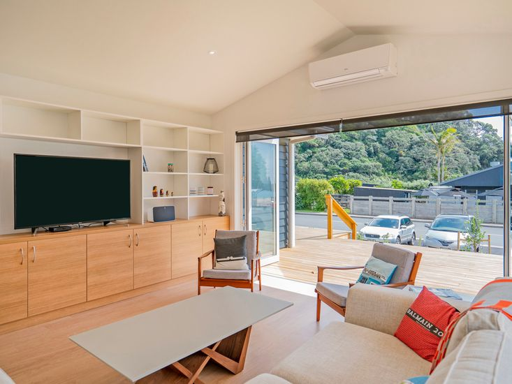 Lounge and TV area opens out onto front sundeck
