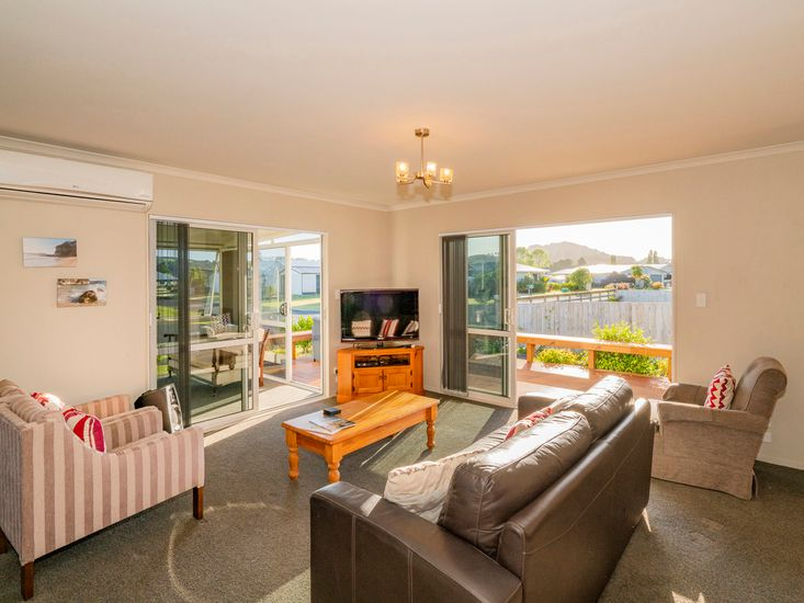 Sunny lounge room opens out to the deck and the sunroom!