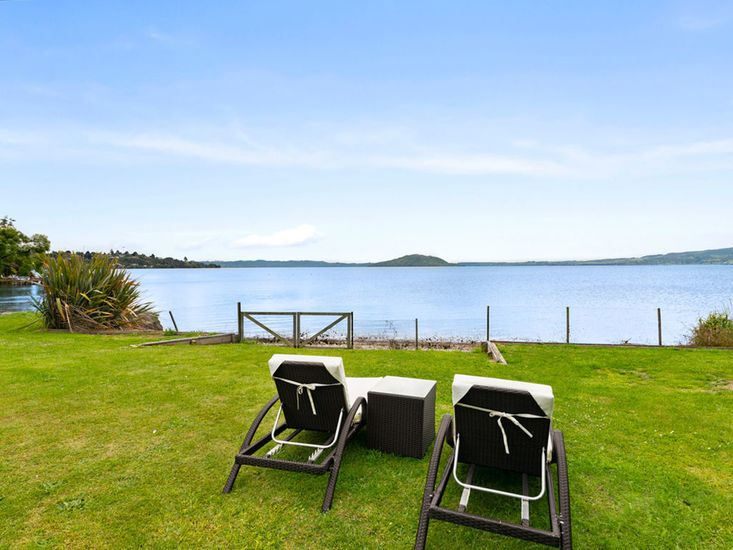Enjoy relaxing on the sun loungers in front of the lake
