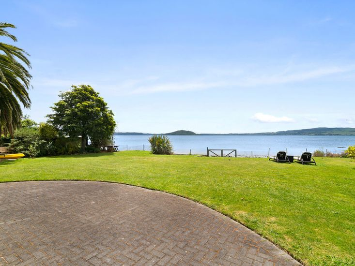 Large flat lawn and garden area right by the lake