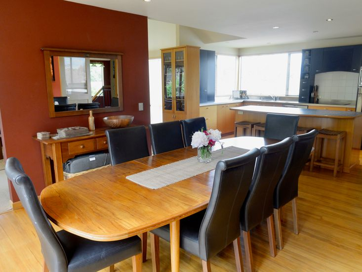 Dining table onto kitchen and living area