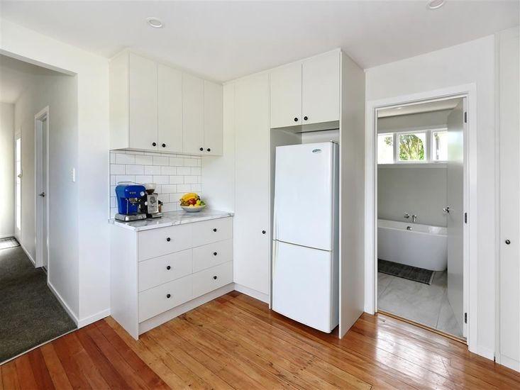 Kitchen onto hallway and bathroom