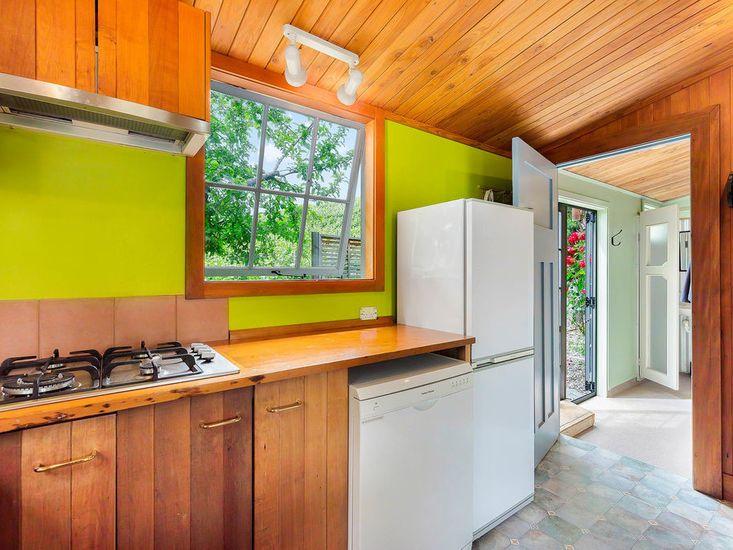 Kitchen onto front door and shower room
