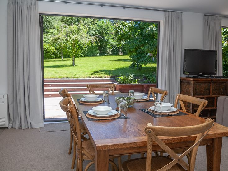 Dining table onto patio and garden