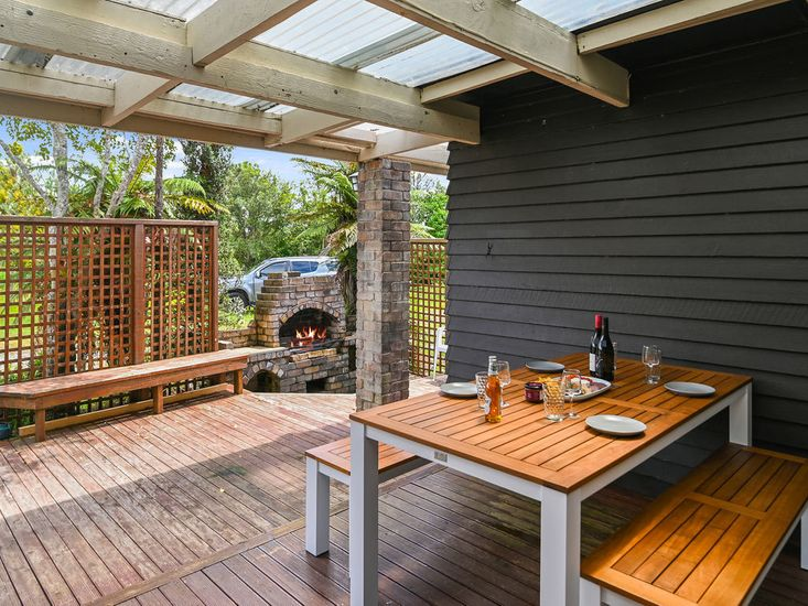 Sheltered outdoor dining and BBQ area!