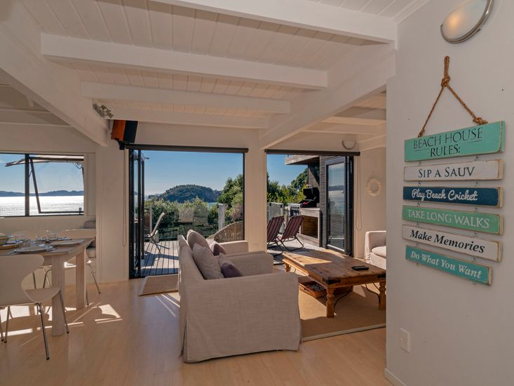 Comfy living space opening onto sunny deck