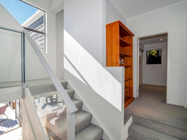 Stairs to mezzanine level and TV room