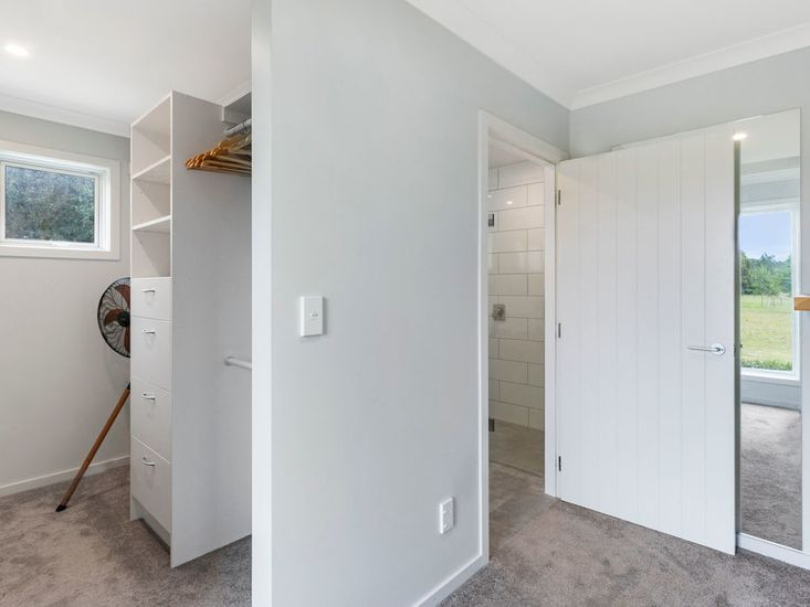 Closet and ensuite to master bedroom