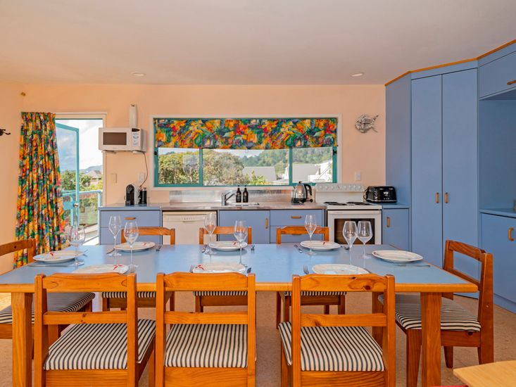 Large dining table and kitchen