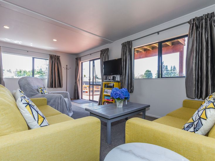 Comfy lounge space opens to the decking
