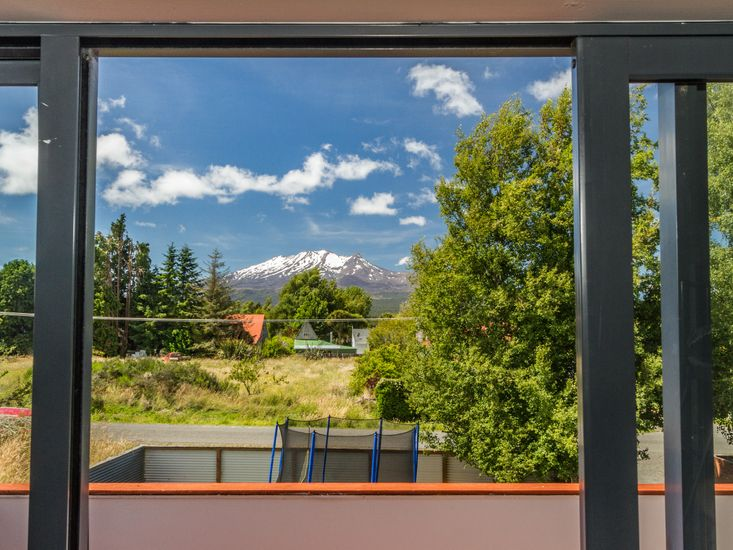 Balcony for master bedroom looks onto view of the mountain