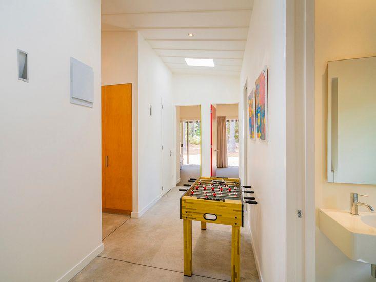Foosball table and hallway onto bedrooms