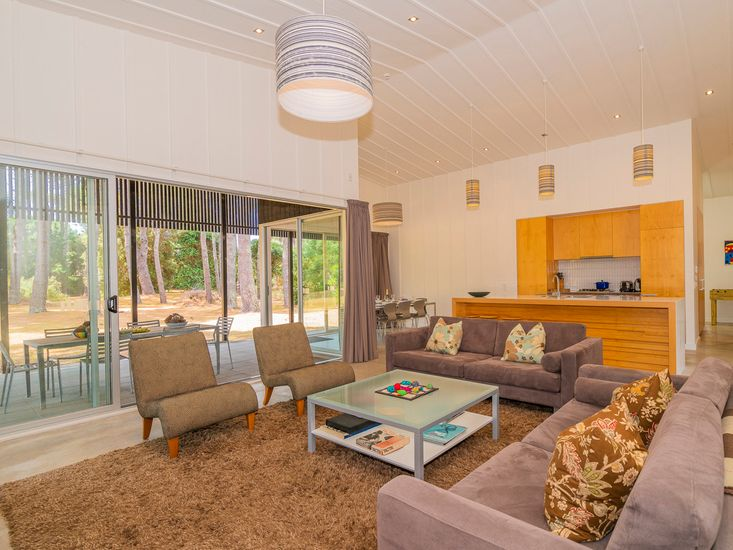 Open plan living, dining and kitchen area opens out to the veranda
