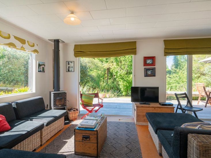 Sunny lounge area opens to the deck