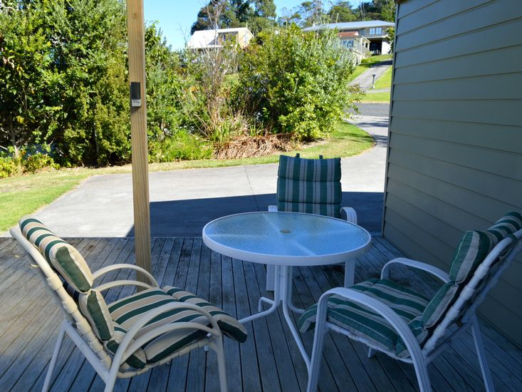 Back deck for sheltered outdoor living and dining