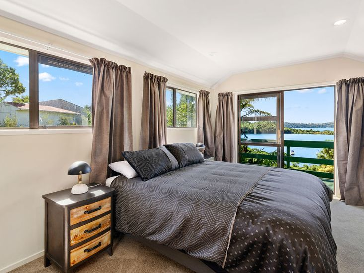 Bedroom 1: opens out to the sundeck with views over the lake