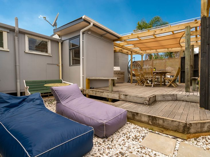 Rear sundeck and bean bags for outdoor living