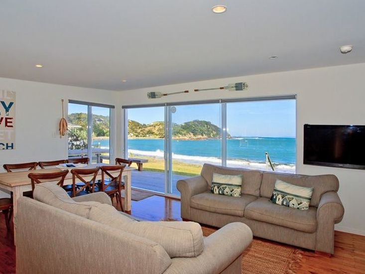 Living area opens out to the decking and the beach