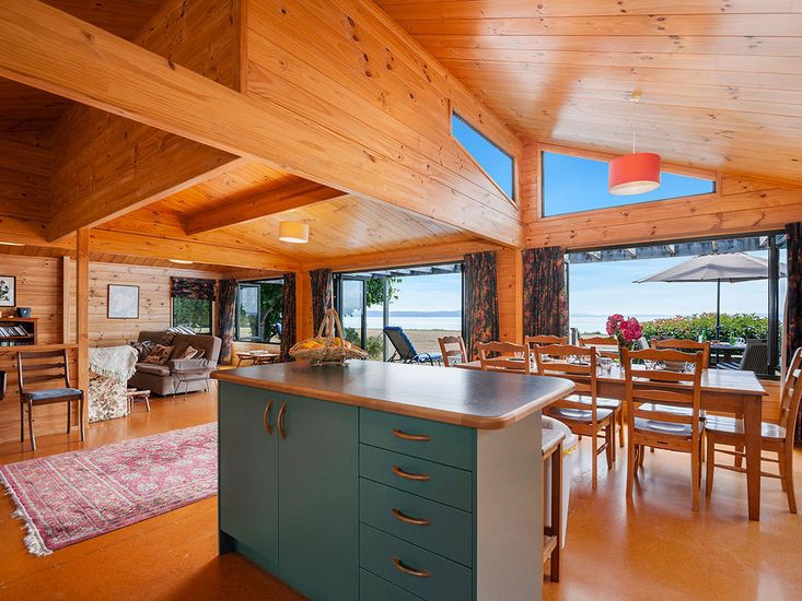 Open plan living, dining and kitchen area opens out to the deck