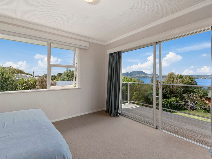 Master bedroom with views of the lake