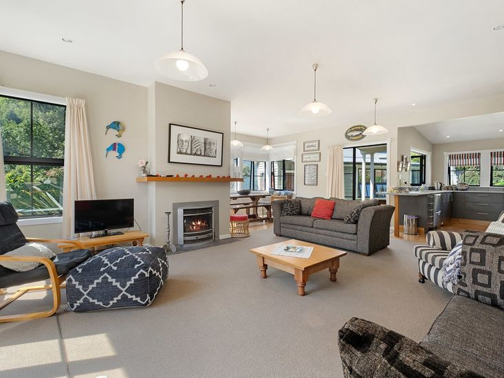 Spacious and comfortable lounge area onto kitchen and dining