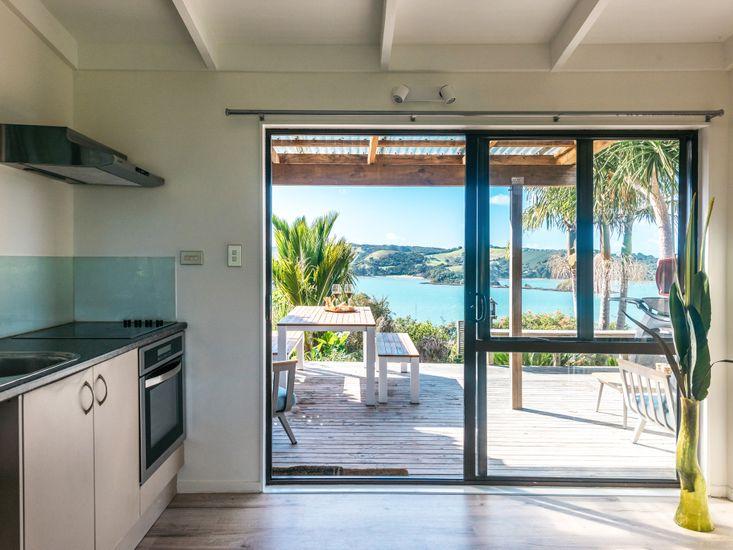 Kitchen opening onto deck