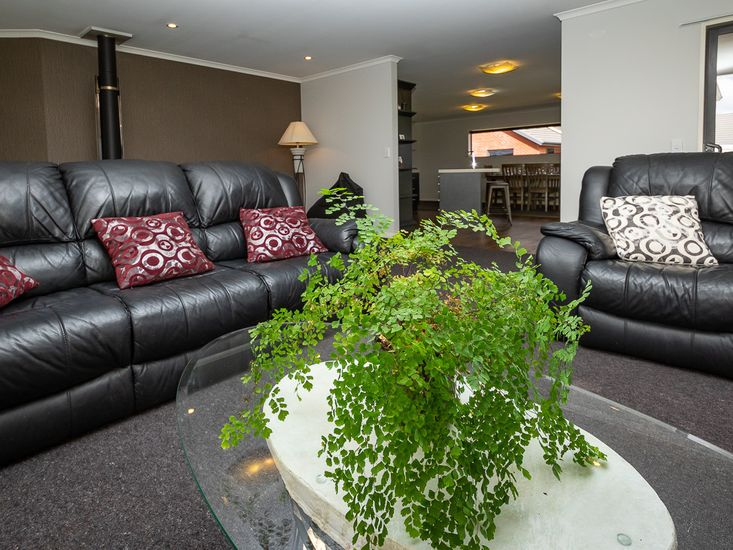 Comfy lounge space onto kitchen and dining area
